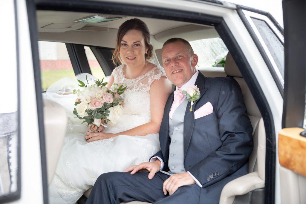 bridal car departing brides home st marks church ceremony pensnett dudley west midlands oxfordshire wedding photography