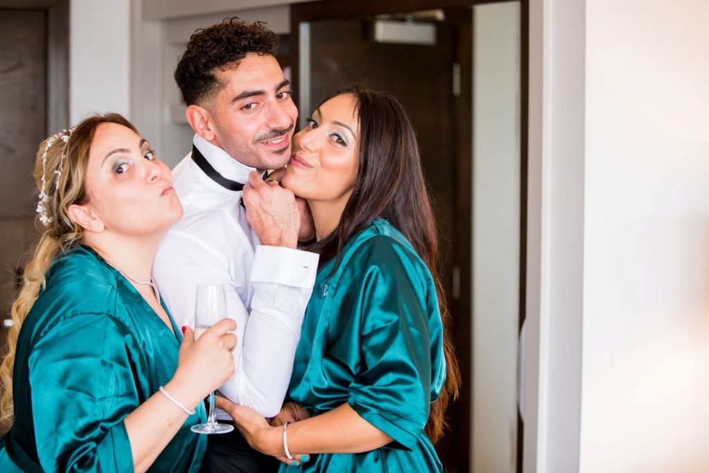 bridesmaids kiss groomsman marylebone hotel london oxfordshire wedding photography