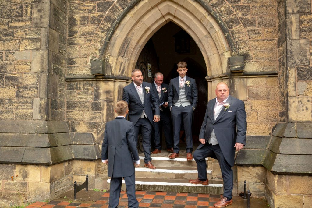 groom groomsn await bride church door st marks pensnett dudley west midlands oxfordshire wedding photography