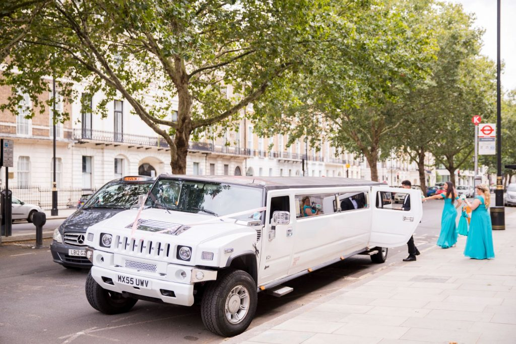 bridal party enter stretch hummer bridal car marylebone hotel london oxfordshire wedding photographer