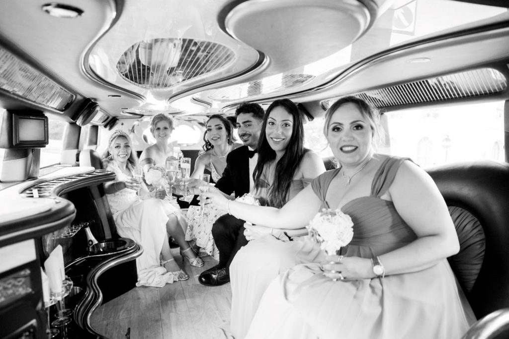 bridal party inside stretch hummer marylebone hotel london oxfordshire wedding photographers