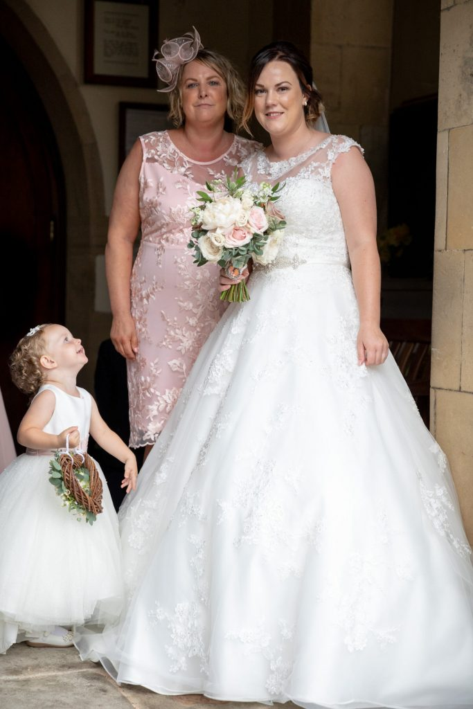 bride mother flowergirl church door st marks pensnett dudley west midlands oxford wedding photographers
