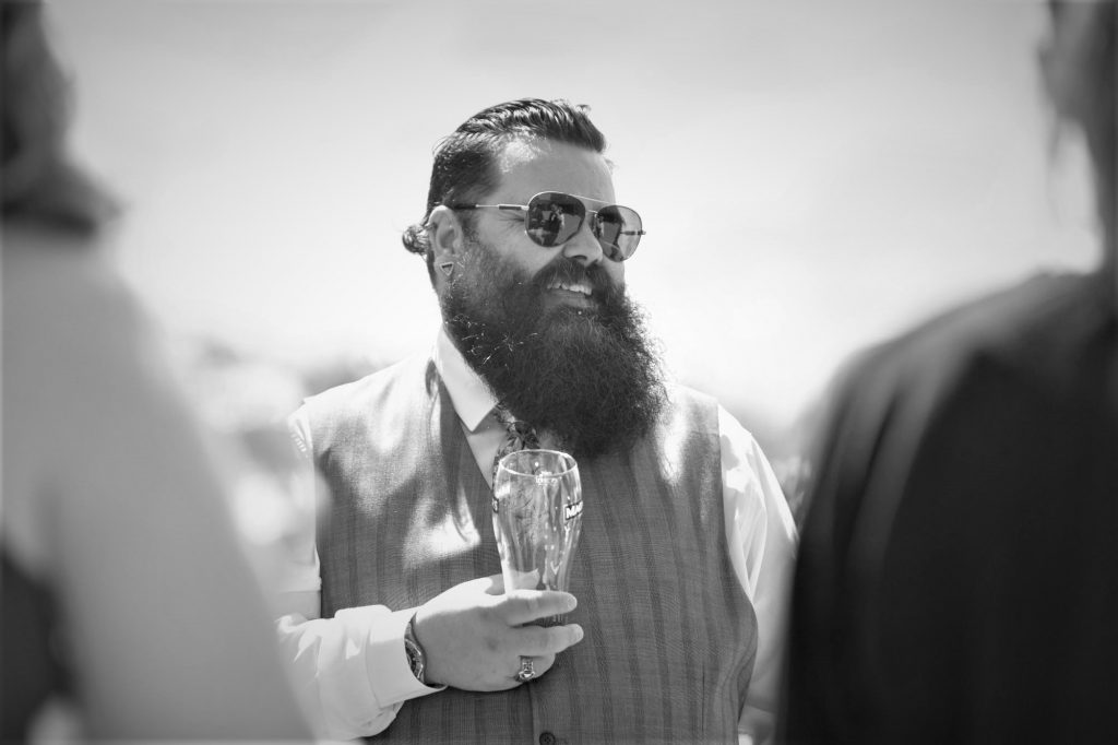 bearded guest enjoys drinks reception manor hill house bromsgrove worcestershire oxford wedding photographers