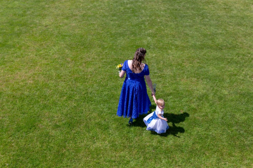 bridesmaid flower girl hold hands manor hill house bromsgrove worcestershire oxford wedding photographers