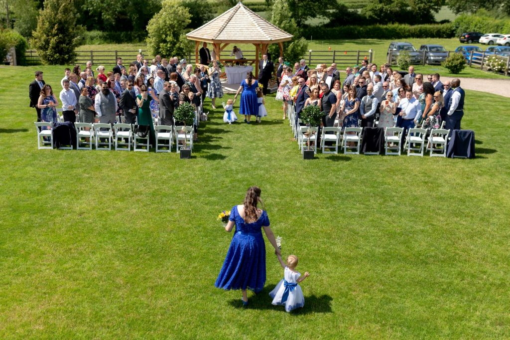 bridesmaid flowergirls walk down aisle manor hill house bromsgrove worcestershire oxford wedding photography