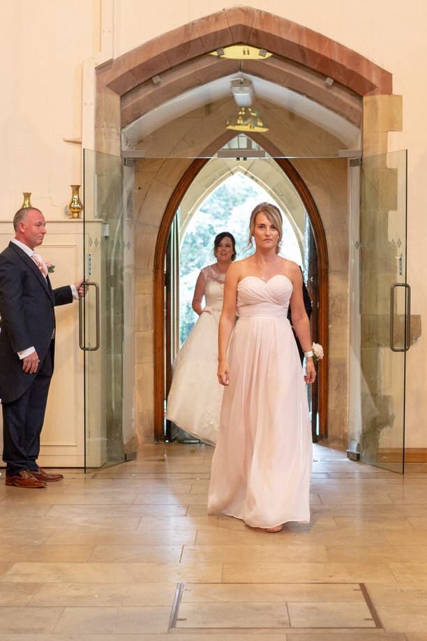 bridesmaid enters church ceremony st marks pensnett dudley west midlands oxfordshire wedding photographers