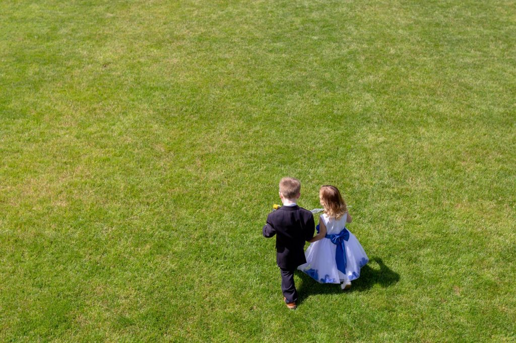 pageboy flowergirl hold hands manor hill house brosmgrove worcestershire oxfordshire wedding photographer