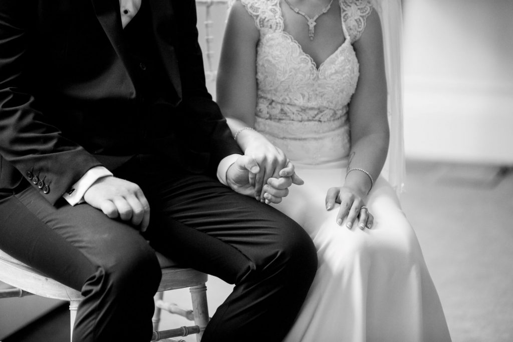 bride groom hold hands marriage ceremony academy of medical sciences portland place london oxford wedding photographers