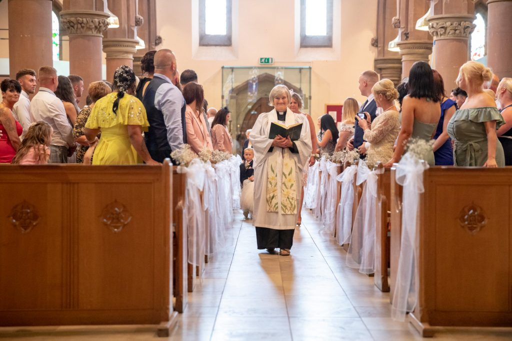 vicar walks down aisle st marks marriage ceremony pensnett dudley west midlands oxfordshire wedding photography