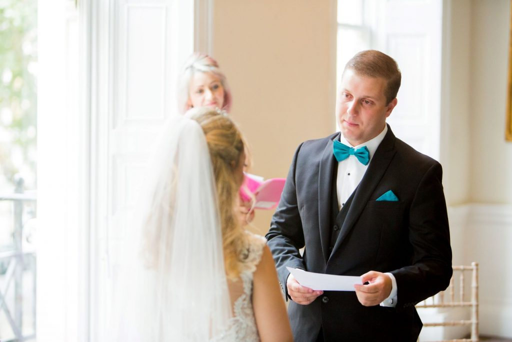 groom reads marriage vows academy of medical sciences portland place london oxfordshire wedding photographer