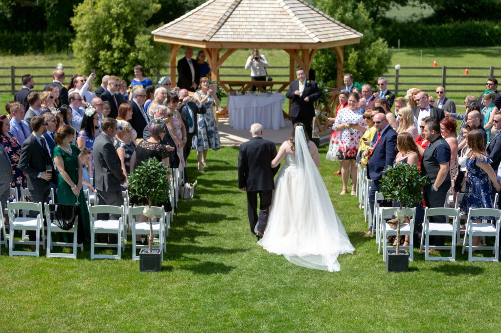 father of bride walks daughter down aisle manor hill house bromsgrove worcestershire oxford wedding photography