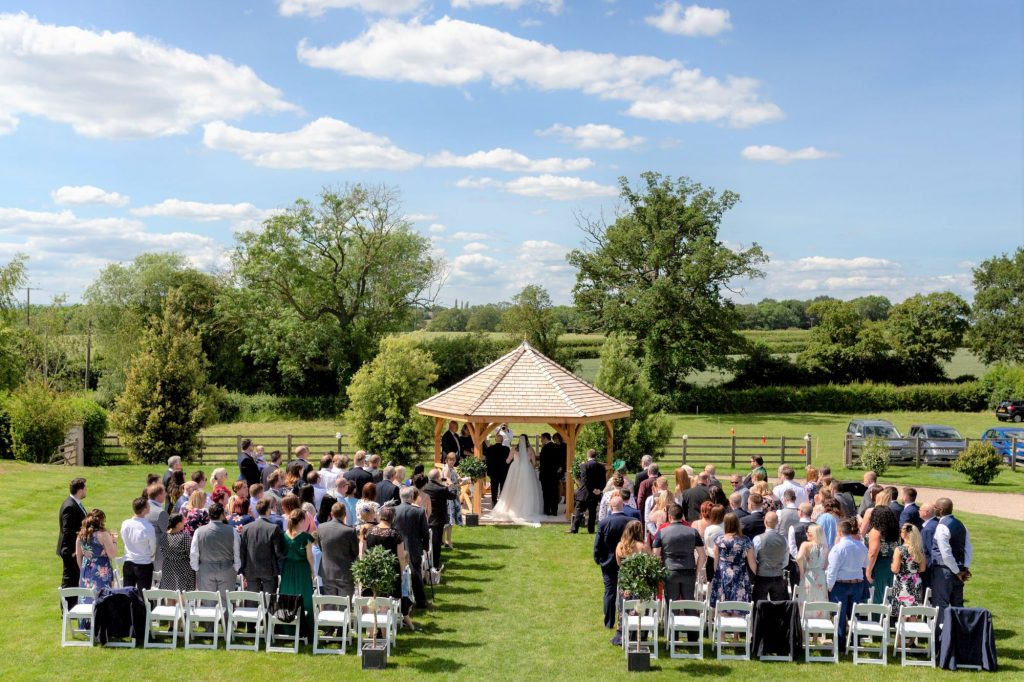 groom meets bride at marriage ceremony arch manor hill house bromsgrove worcestershire oxfordshire wedding photographer