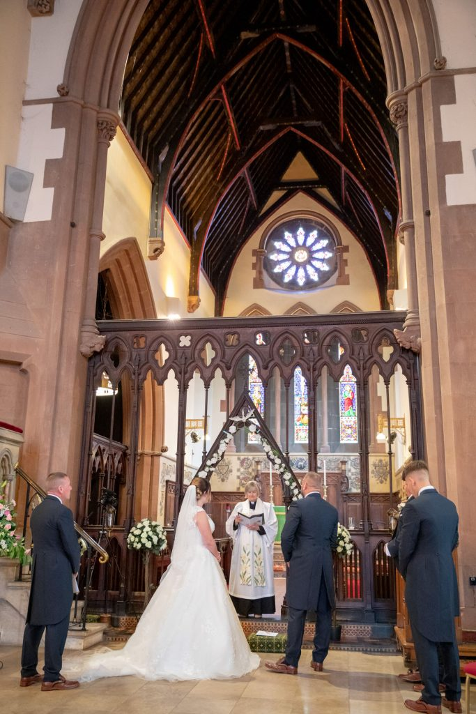 vicar conducts marriage ceremony st marks church pensnett dudley west midlands oxfordshire wedding photography