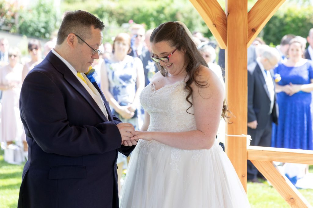 bride groom exchange rings open air marriage ceremony manor hill house bromsgrove worcestershire oxfordshire wedding photography