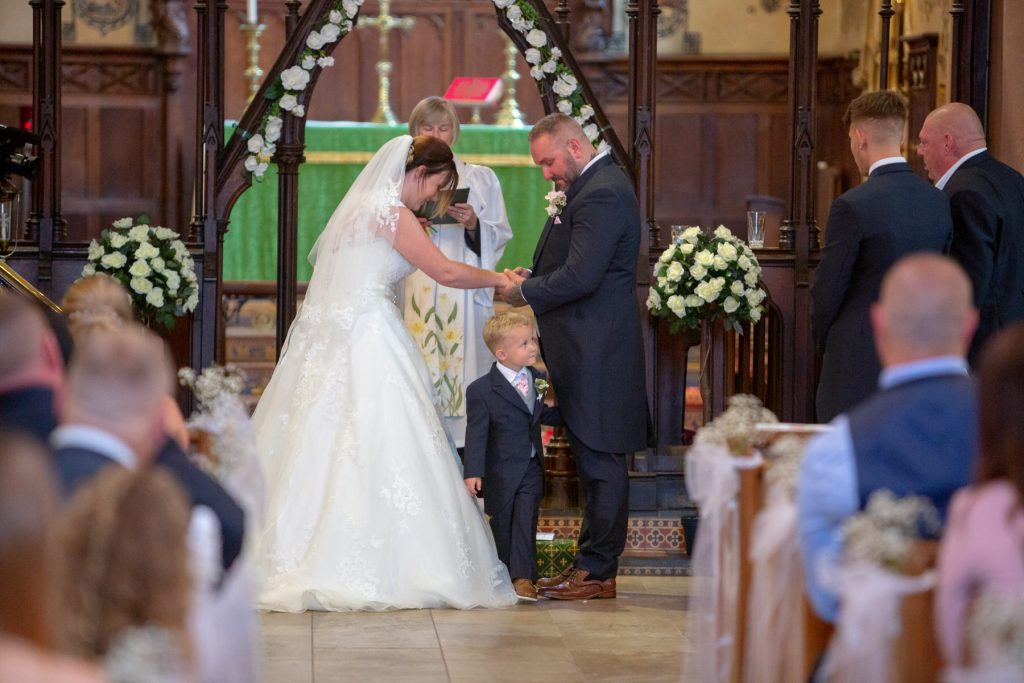 bride groom watch pageboy marriage ceremony st marks church pensnett dudley west midlands oxford wedding photographer