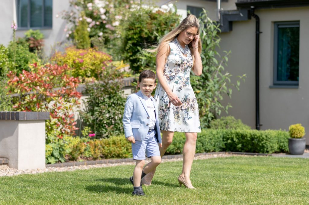 young guest holding hands with mother manor hill house bromsgrove worcestershire oxford wedding photographer