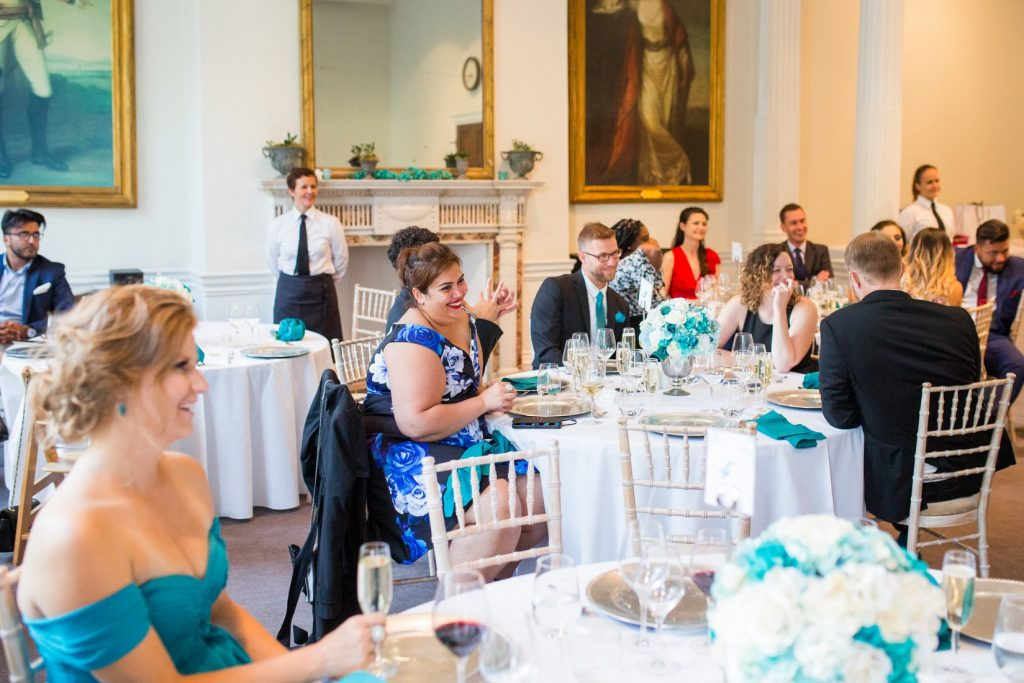 guests hear bestmans speech academy of medical sciences portland place london oxford wedding photographers