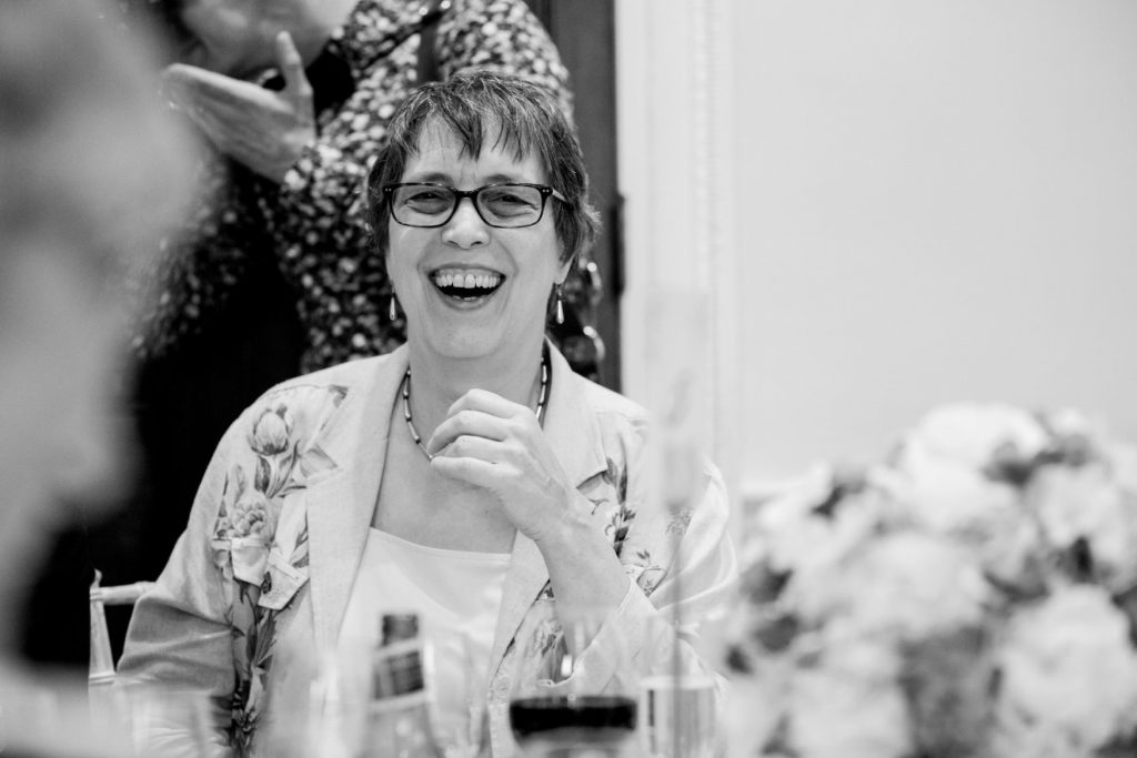 laughing dinner reception guest academy of medical sciences venue portland place london oxford wedding photography