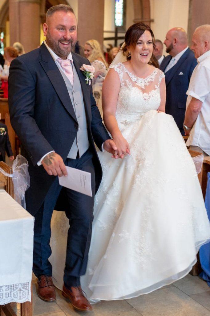 smiling bride groom hold hands st marks church pensnett dudley west midlands oxford wedding photography