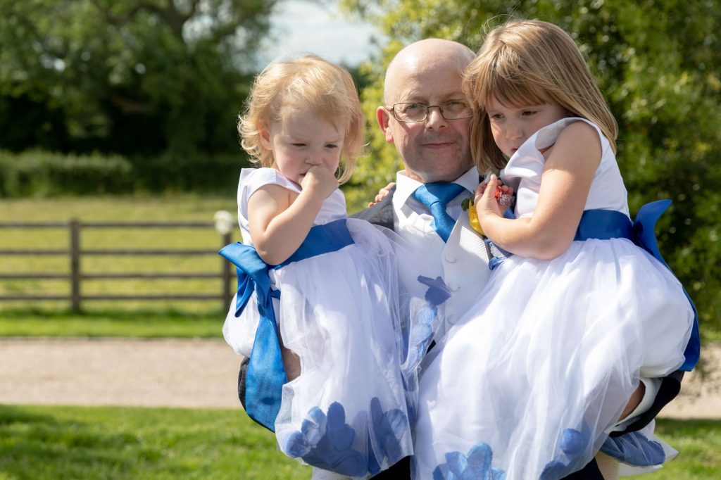 guest carries two flowergirls manor hill house bromsgrove worcestershire oxfordshire wedding photography