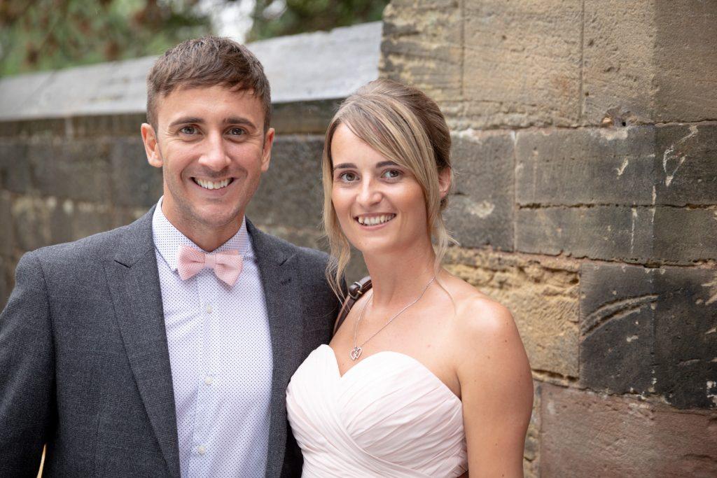 bridesmaid with escort st marks churchyard pensnett dudley west midlands oxfordshire wedding photography