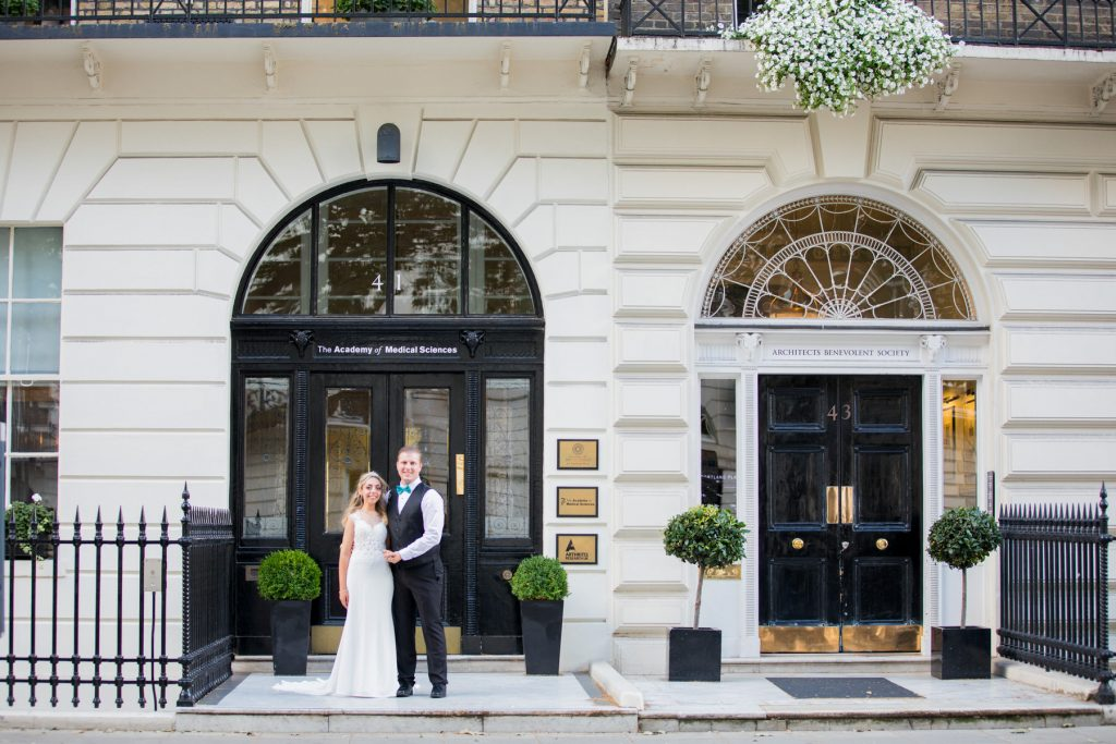 bride groom academy of medical sciences reception entrance portland place london oxford wedding photography