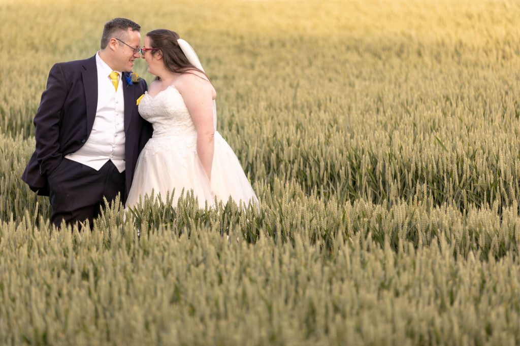 laughing bride groom in cornfield manor hill house bromsgrove worcestershire oxford wedding photography