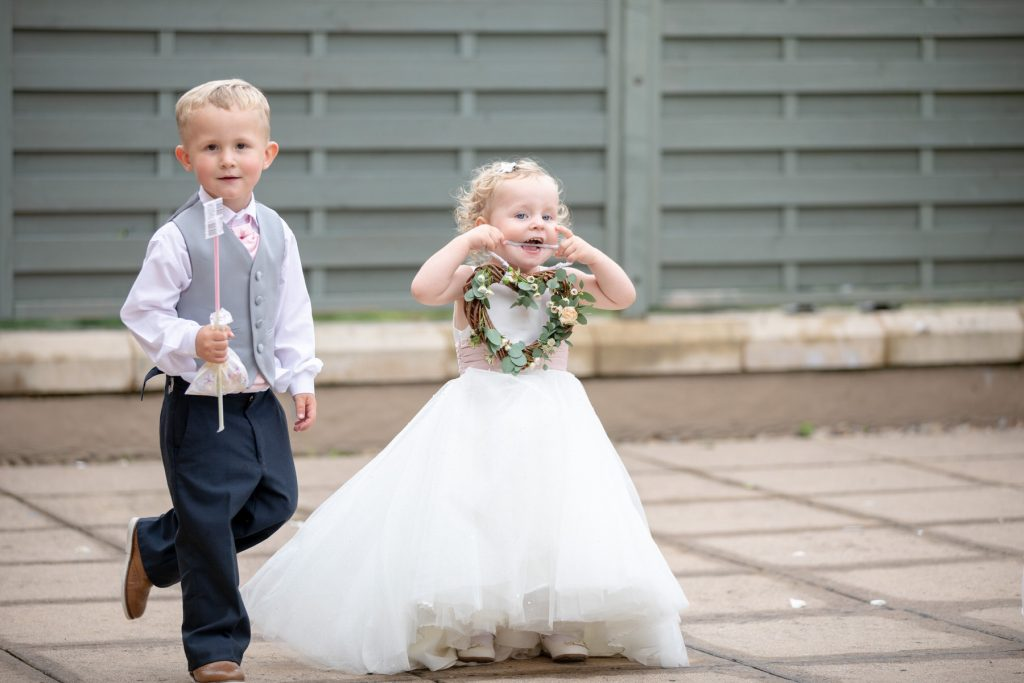 page flowergirl with floral heart village hotel club venue dudley birmingham oxford wedding photographers