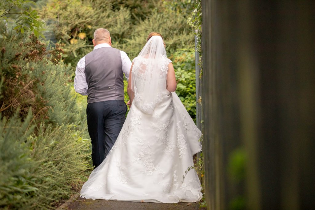 bride groom stroll grounds village hotel club venue dudley birmingham oxfordshire wedding photographer