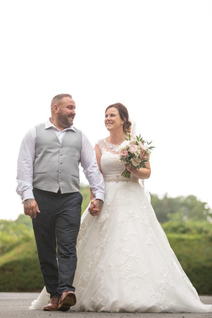 groom bride floral bouquet hold hands village hotel club grounds dudley birmingham oxfordshire wedding photography
