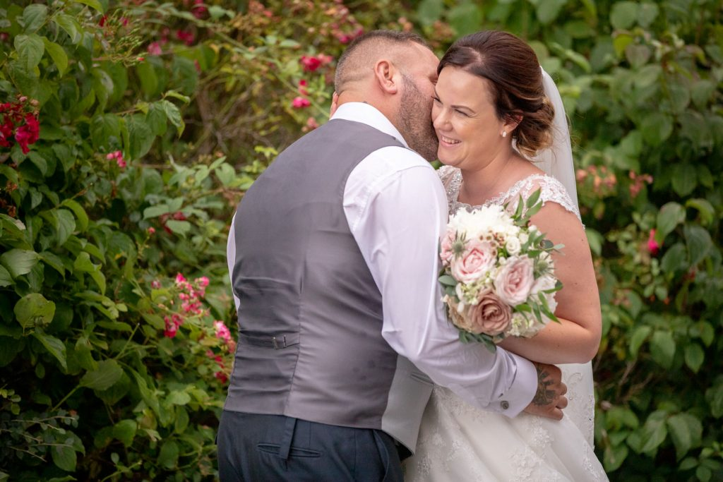 bride groom embrace village hotel club gardens dudley birmingham oxford wedding photographer