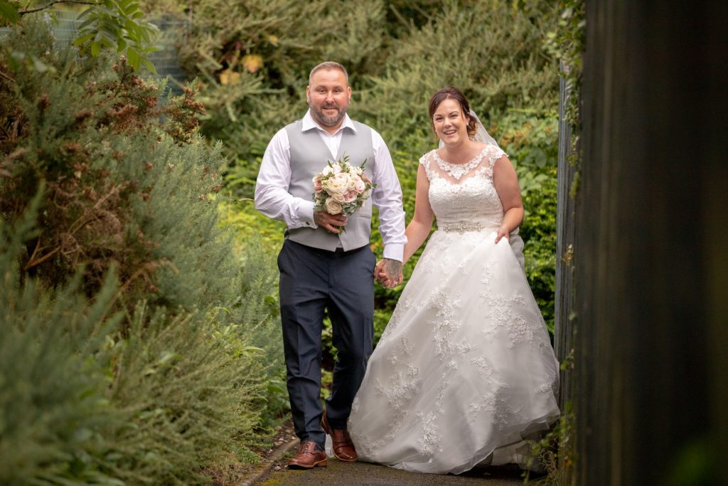 broom holds brides bouquet village hotel club gardens dudley birmingham oxford wedding photographers