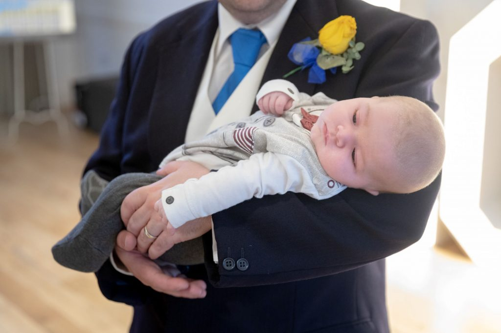 groomsman holds baby manor hill house bromsgrove worcestershire oxfordshire wedding photography