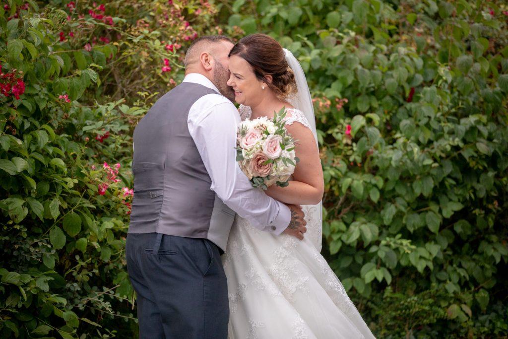 bride groom hug village hotel club grounds dudley birmingham oxfordshire wedding photographer