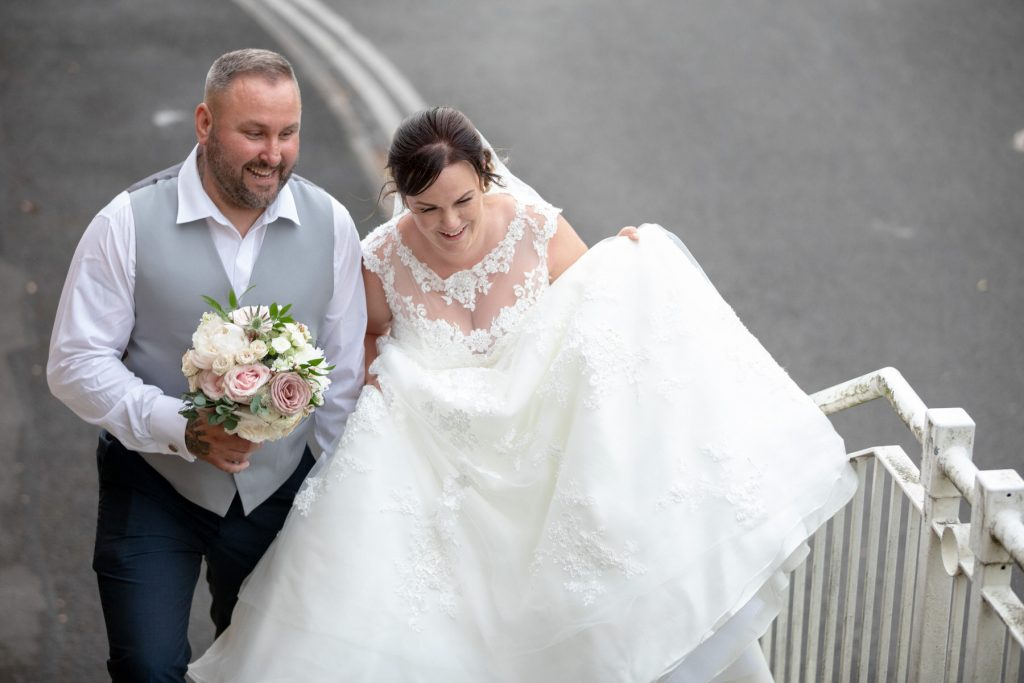 bride groom climb steps village hotel club grounds dudley birmingham oxfordshire wedding photographers