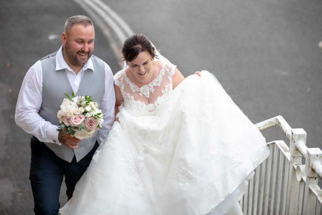 bride groom climb steps village hotel club grounds dudley birmingham oxfordshire wedding photographers
