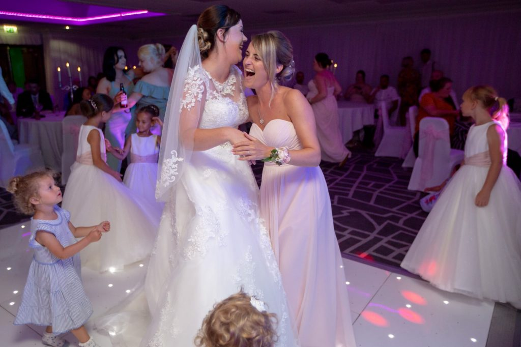 laughing bride bridesmaid dance village hotel club dudley birmingham oxford wedding photographers