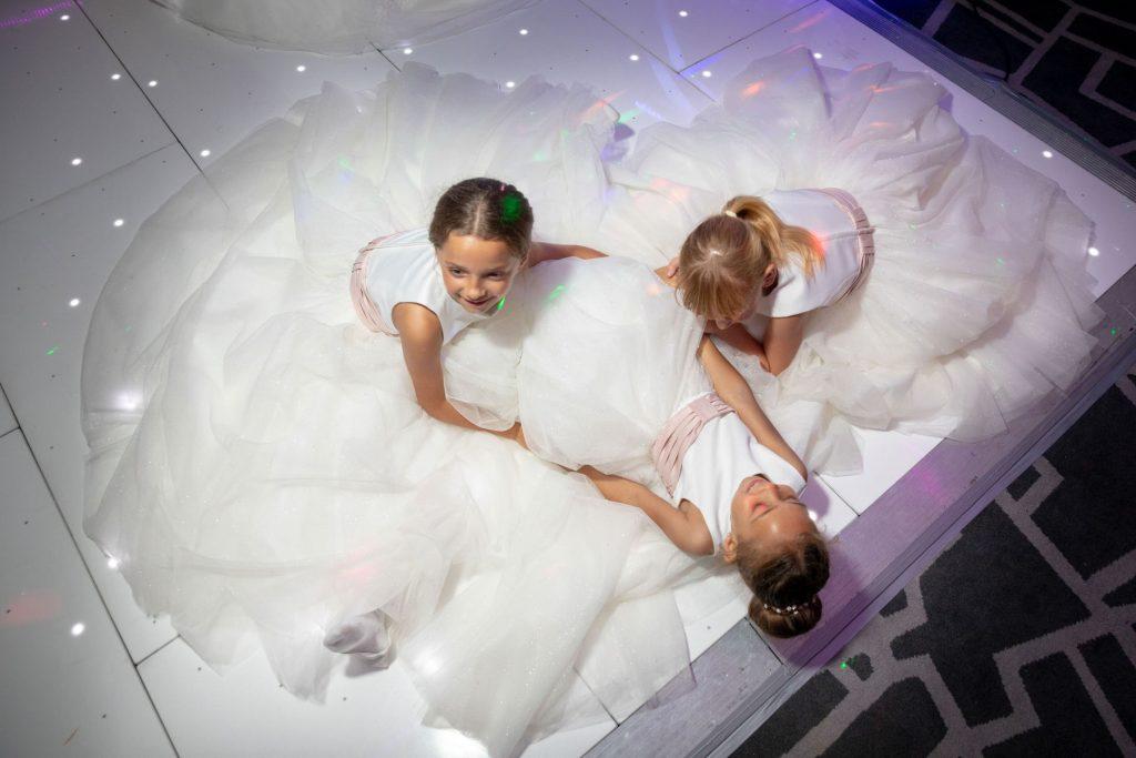 flowergirls on dance floor village hotel club dudley birmingham oxford wedding photography