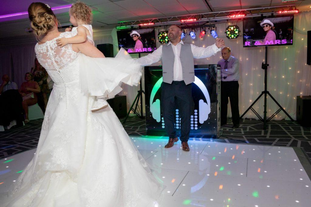 groom sings to bride holding flowergirl village hotel club dudley birmingham oxfordshire wedding photographer