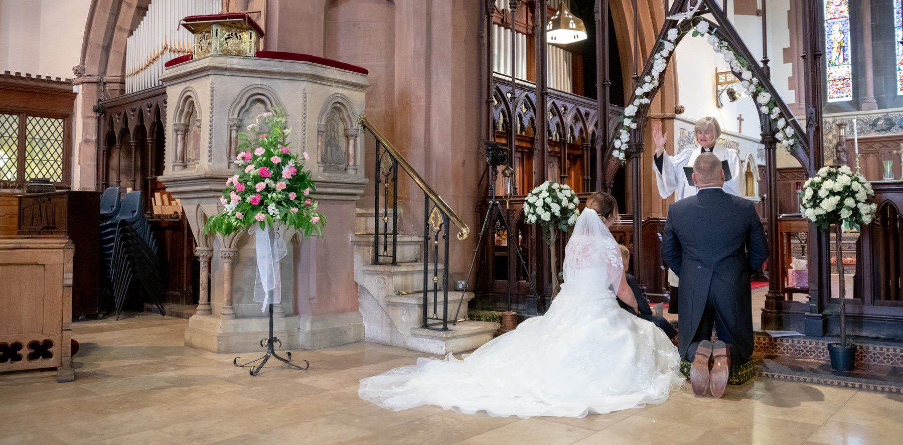 bride groom kneel marriage ceremony st marks church pensnett dudley west midlands oxford wedding photographer