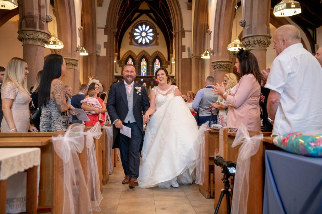 bride groom walk down aisle st marks church pensnett dudley west midlands oxfordshire wedding photographers