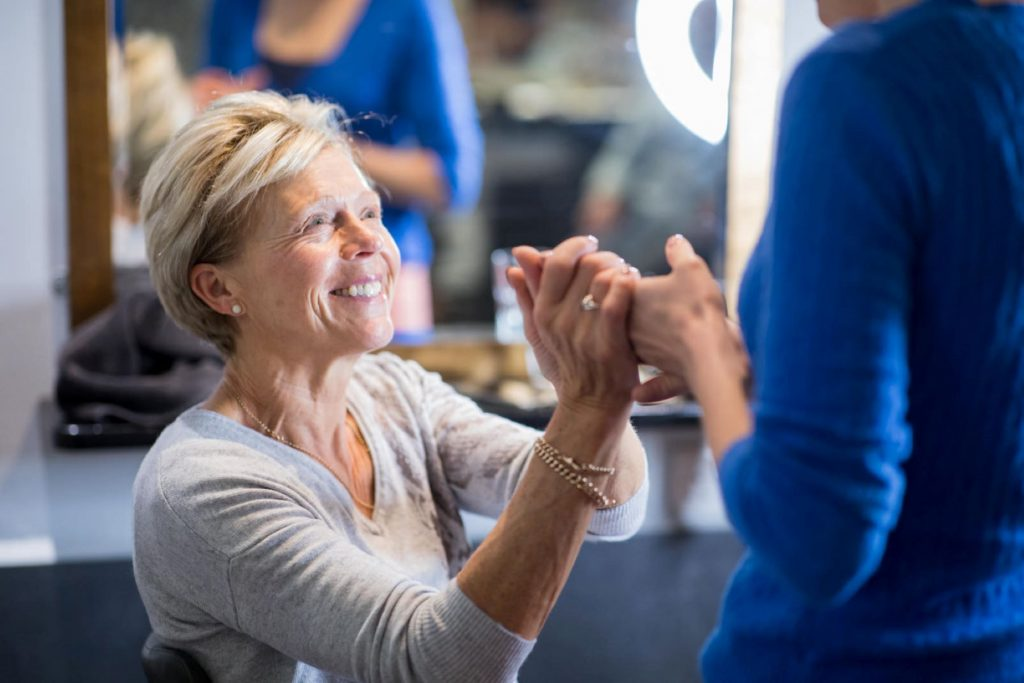 smiling mother of bride bridal preparation blenheim palace woodstock venue oxfordshire wedding photographers