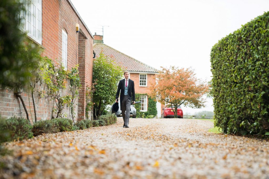 groom leaves brides home church of st michael aston tirrold ceremony oxfordshire wedding photography
