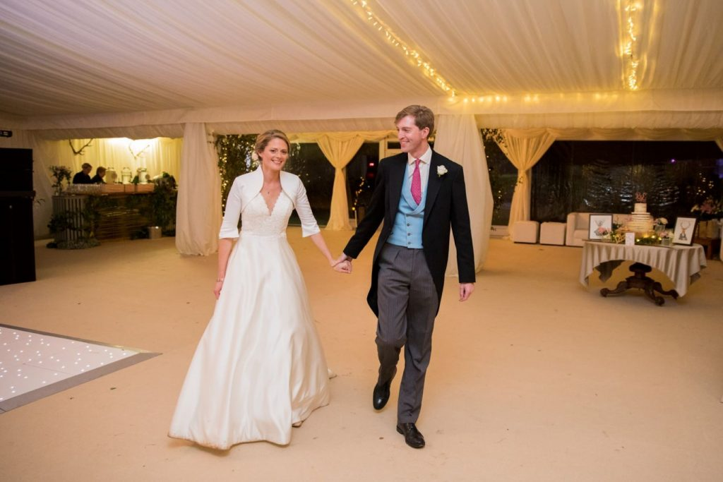 bride groom enter marquee reception blenheim palace woodstock oxfordshire wedding photographer