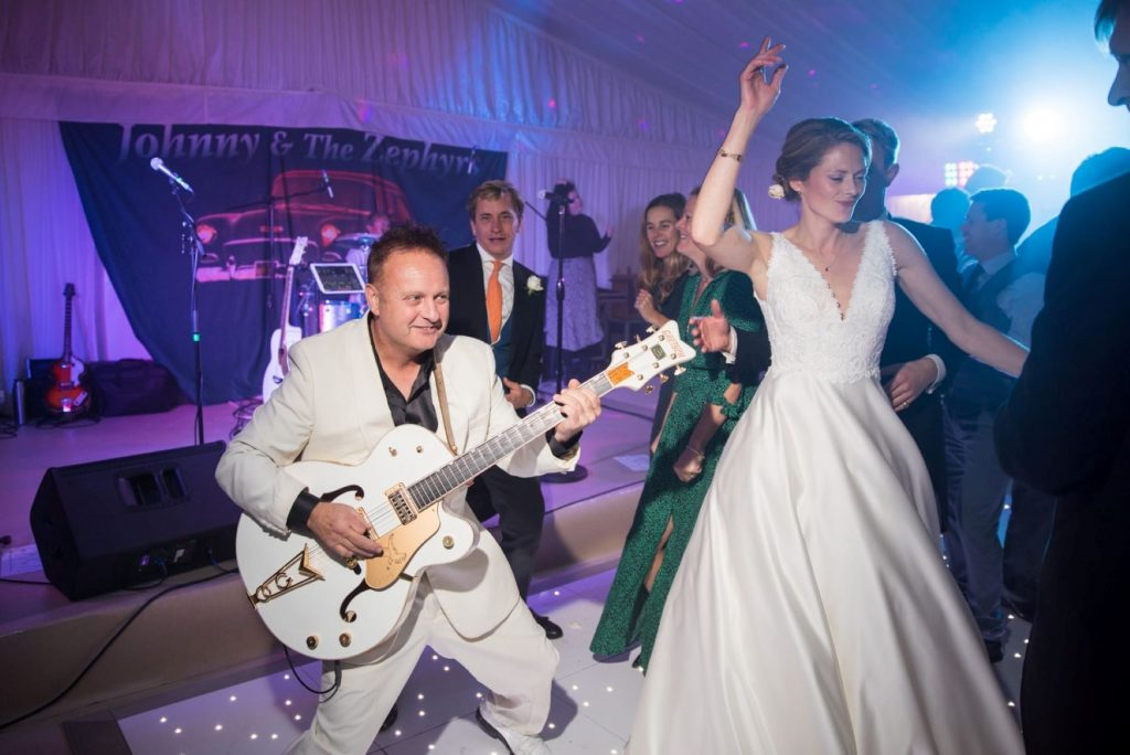 muscian plays guitar bride dances marquee reception blenheim palace woodstock oxford wedding photographer