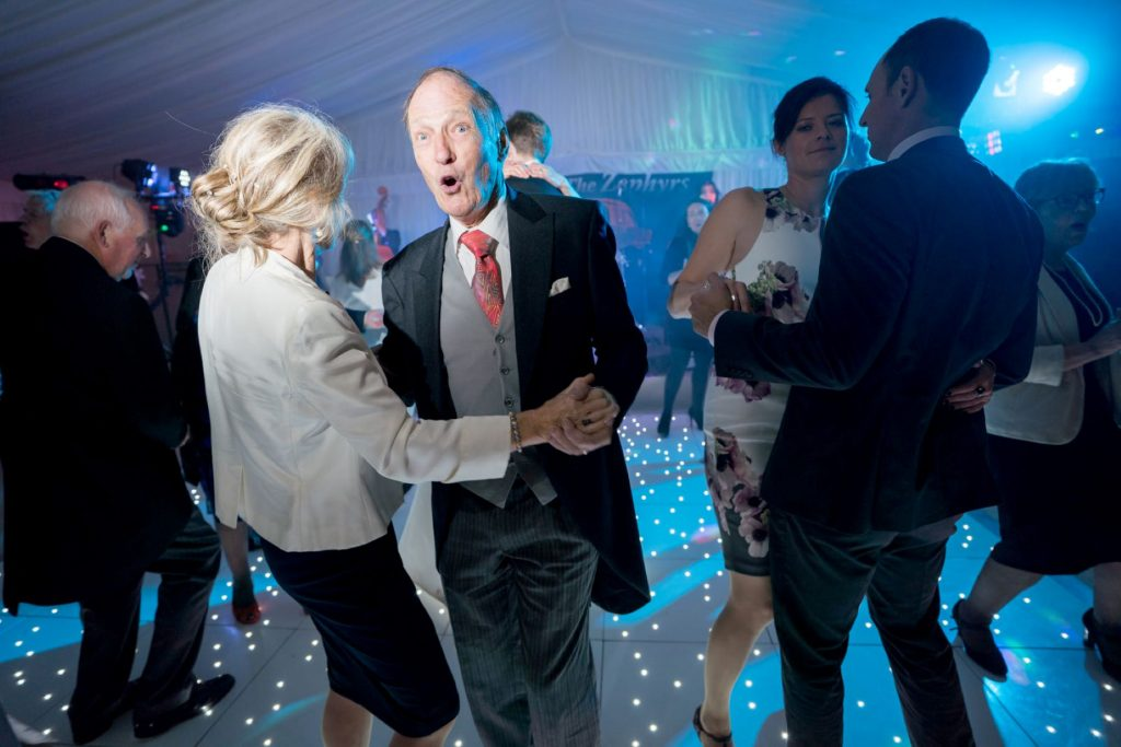 formally dressed guest dances marquee reception blenheim palace woodstock oxfordshire oxford wedding photography