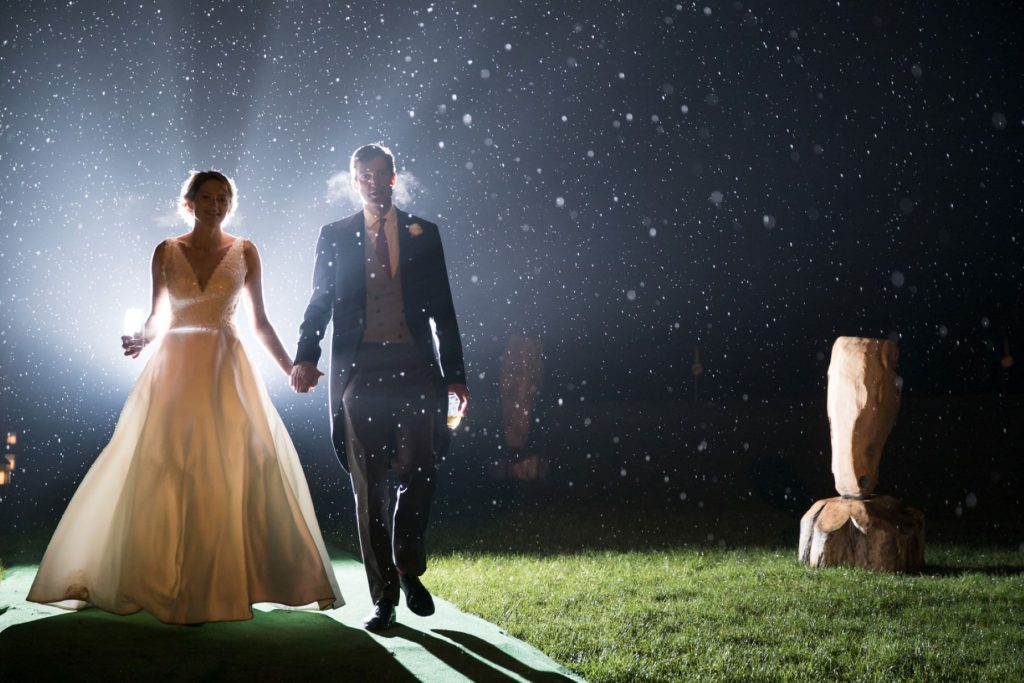 bride groom hold hands nightime stroll blenheim palace grounds woodstock oxfordshire oxford wedding photographers