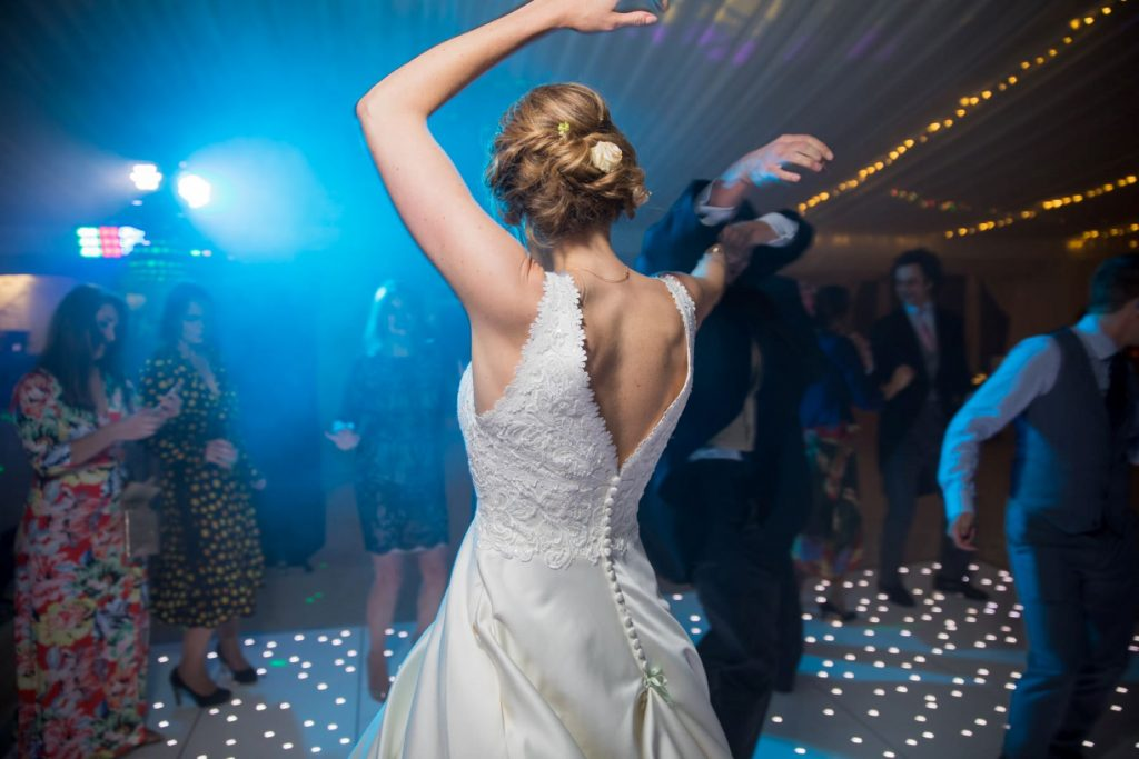 bride dances under fairly lights marquee reception blenheim palace woodstock oxfordshire oxford wedding photography