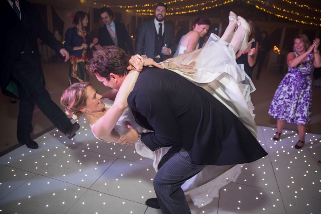 bride dances rocknroll marquee reception blenheim palace woodstock oxfordshire wedding photographer