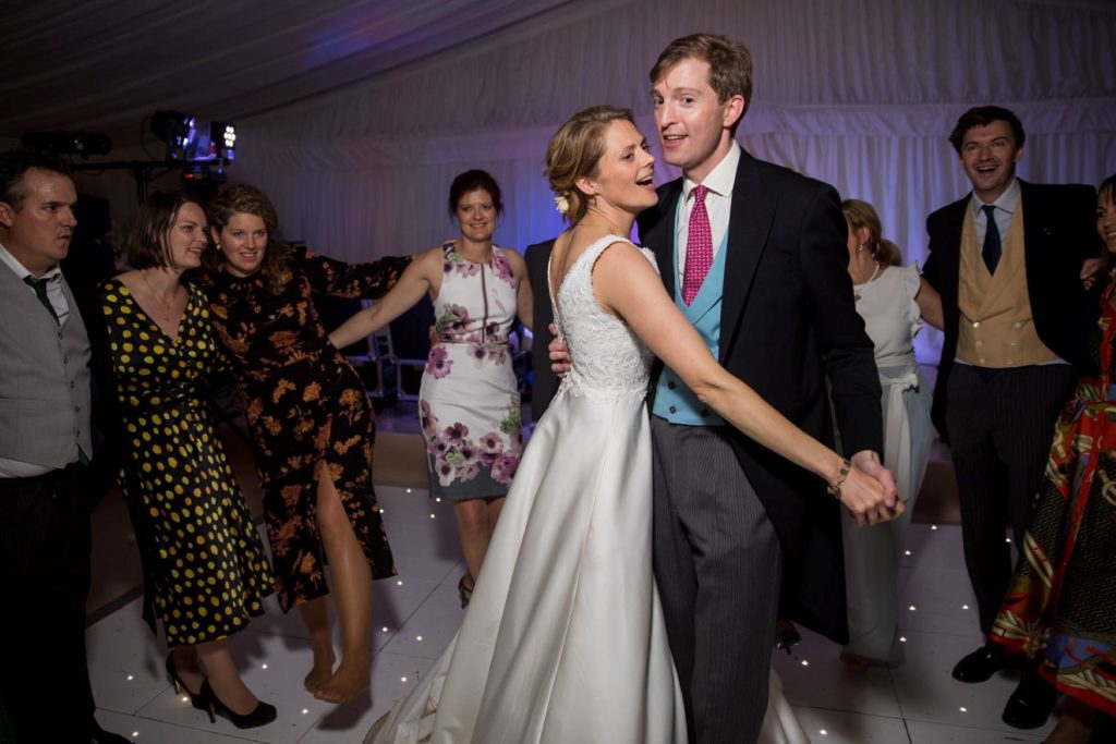 smiling bride groom dance marquee reception blenheim palace venue woodstock oxfordshire wedding photography